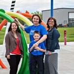 2013 winner Rachel Kraynick from Canora Saskatchewan standing at the Chase Kraynick Memorial Splash Park.